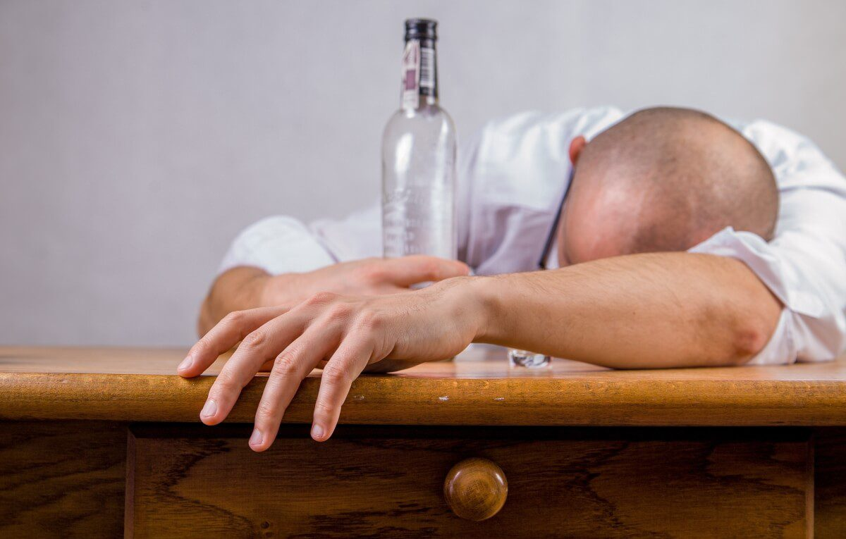 drunk man with a bottle